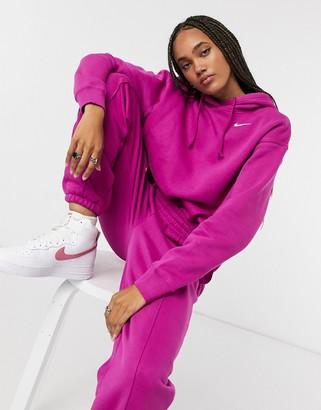 Nike mini swoosh oversized hoodie in purple