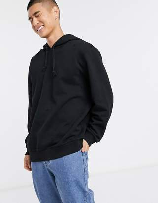 Asos Design DESIGN relaxed hoodie with distressing in black