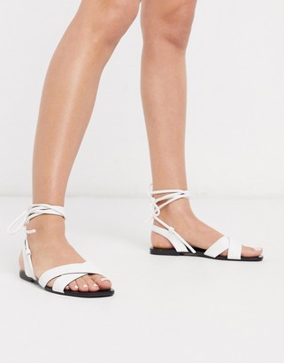 Qupid tie leg flat sandals in white