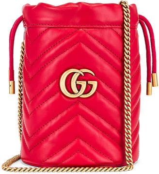 Gucci Leather Chain Bucket Bag in Hibiscus Red | FWRD