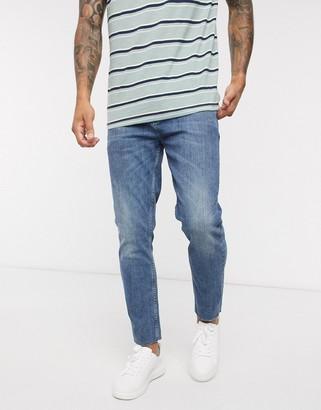 ASOS DESIGN cropped skinny jeans in vintage dark wash with raw hem