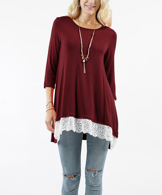 Lydiane Women's Tunics DKBURGUNDY - Dark Burgundy Crewneck Three-Quarter Sleeve Lace-Trim Hi-Low Tunic - Women & Plus