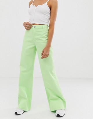 Asos Design DESIGN full length wide leg jeans in neon pastel green with deep hem detail