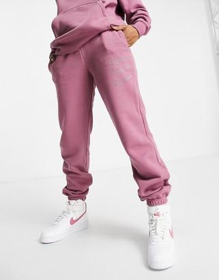 Nike Swoosh rhinestone applique washed cuffed sweatpants in pink