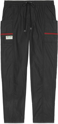 Gucci Cotton canvas trousers with label