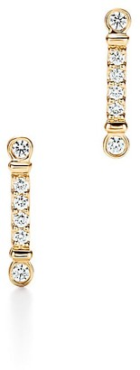 Tiffany & Co. Fleur de Lis key bar earrings in 18k gold with diamonds