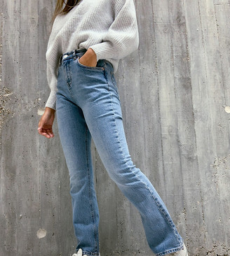ASOS DESIGN Petite high rise '70's' kick flare jeans in midwash