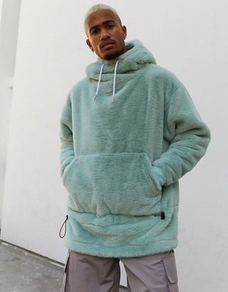Asos Design DESIGN oversized faux fur hoodie with funnel neck & bungee details in blue gray-Green