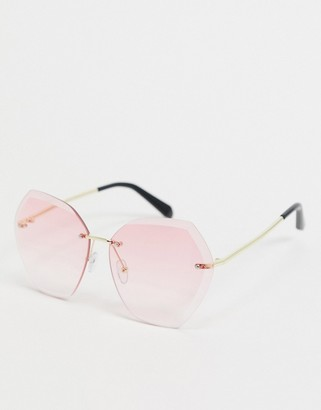 SVNX hexagon sunglasses in gold with pink lens