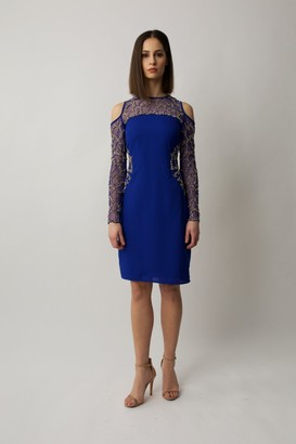 Raishma Cobalt blue midi long sleeve dress with cold cut shoulders and gold embelishment on the waist and arms.