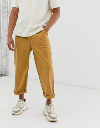 ASOS relaxed pants in mustard with contrast stitching