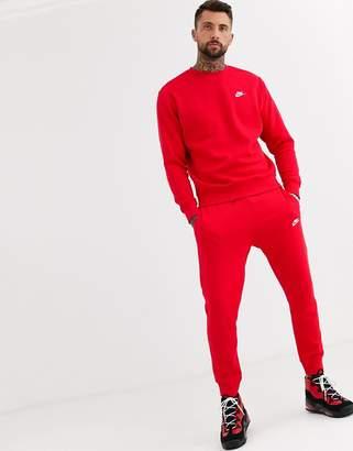 Nike Club cuffed joggers in red
