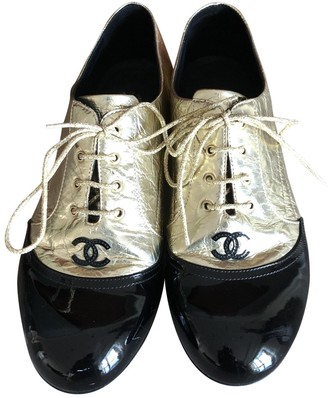 Chanel Gold Patent leather Lace ups
