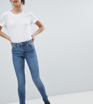 Monki Mocki mid waist slim jeans with organic cotton in mid blue
