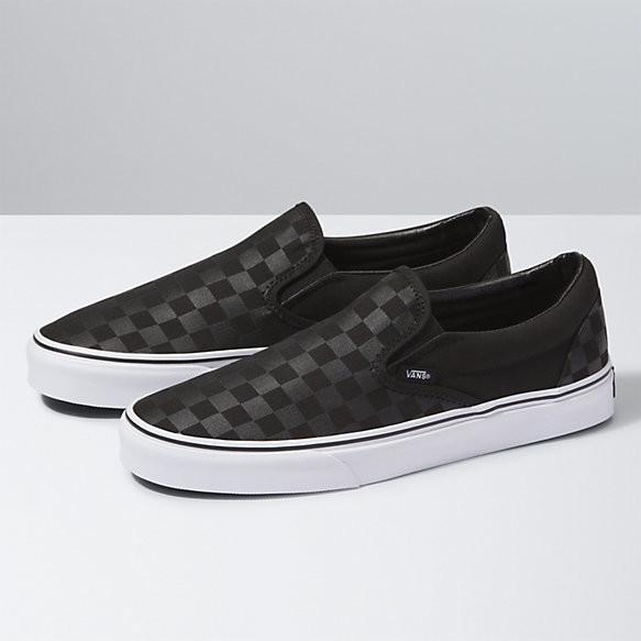 vans black and grey checkered slip ons