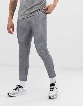 Mauvais cropped trousers in grey pinstripe