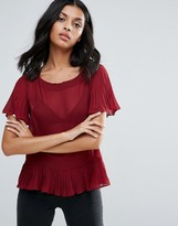 Girls On Film Sheer Top With Peplum Hem