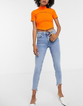 Topshop jagged hem Jamie jeans in bleach wash