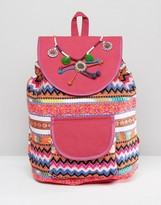 Glamorous Bright Print Backpack With Pom & Tassel Detail