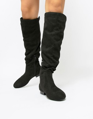ASOS DESIGN Connie faux shearling knee boots