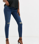 Asos DESIGN Maternity Ridley high waisted skinny jeans in dark stonewash blue with busted knee with under the bump waist