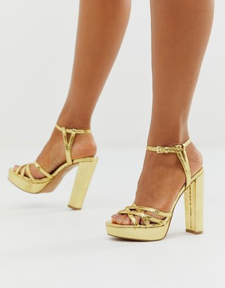 ASOS DESIGN Nickle strappy platform barely there in gold snake