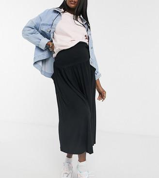 Asos DESIGN Maternity midi skirt with pockets in black