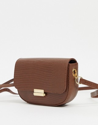 Truffle Collection saddle cross body bag