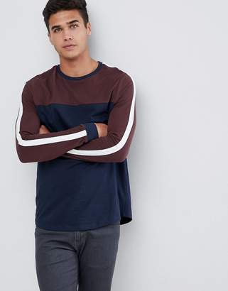 Asos Design DESIGN longline long sleeve t-shirt with curved hem and contrast yoke in navy