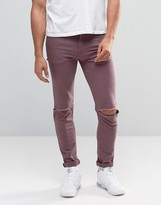 Asos Skinny Jeans With Knee Rips In Purple