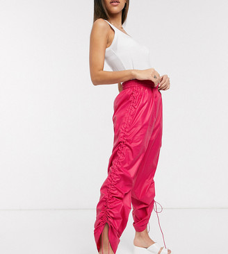 Collusion wide leg wet look trousers in pink