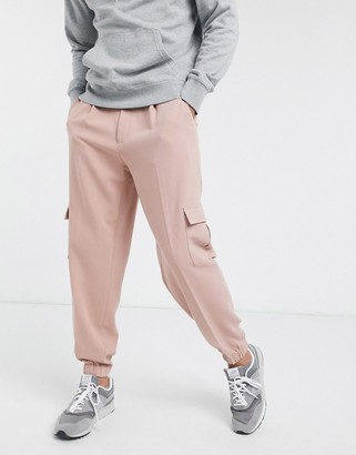 ASOS DESIGN oversized tapered smart jogger trousers in pink with cargo pocket