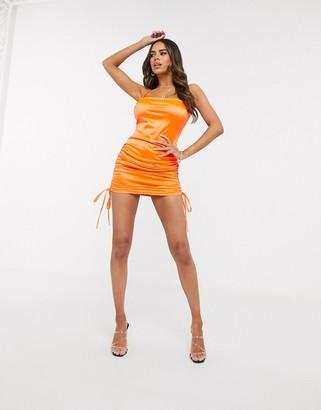 Saint Genies satin mini slip dress with side tie in neon orange