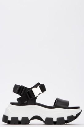 Prada Pegasus Platform Sandals