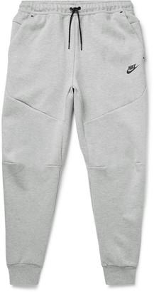 Nike Sportswear Tapered Logo-Print Melange Cotton-Blend Tech-Fleece Sweatpants