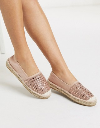 Accessorize flat espadrilles in rose gold