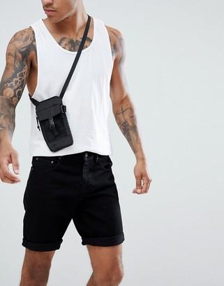 ASOS DESIGN denim shorts in slim black