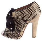 Alaia Stud-Accented Lace-Up Sandals