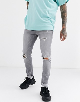 Topman skinny jeans with rips in washed grey