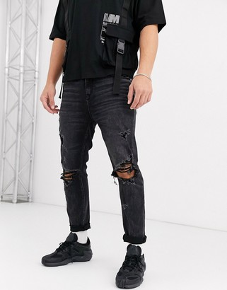 Asos DESIGN carrot fit jeans in washed black with heavy rips