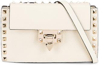 Valentino Small Cross Body Bag in Light Ivory | FWRD