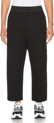 Yohji Yamamoto Terry Cropped Pants in Black   FWRD