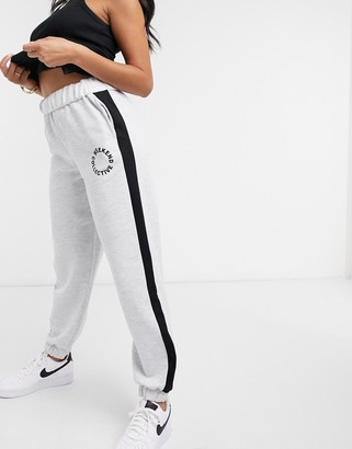 ASOS DESIGN Weekend Collective oversized jogger with roll waist and logo in grey marl