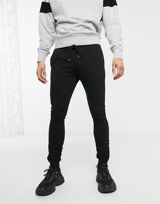 ASOS DESIGN super skinny sweatpants in black with silver zip cuffs