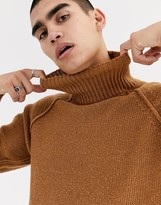 Asos Design DESIGN oversized fluffy roll neck sweater with burst seams in tan
