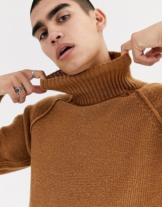 Asos DESIGN oversized fluffy roll neck sweater with burst seams in tan