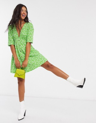 ASOS DESIGN tea dress with horn buttons in green base floral