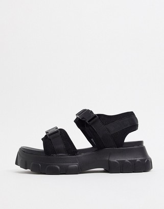 Truffle Collection sporty flatform buckle sandals in black