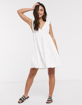 ASOS DESIGN mini sundress with tie detail straps in white