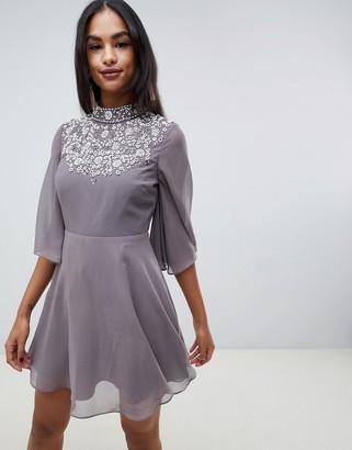 ASOS DESIGN mini dress with flutter cape and pretty pearl embellishment